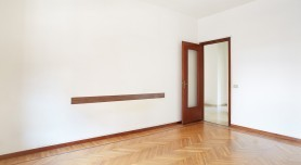 Empty room with wooden floor in normal apartment