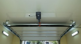 Automatic device for garage door inside
